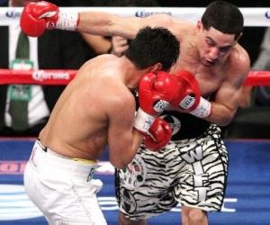 García se impuso a Morales en cuatro asaltos