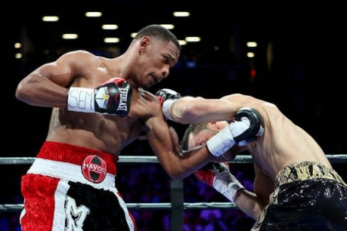 Danny Jacobs TKO'd Sergio Mora at 2:55 in round two to retain his WBA World middleweight title. (Photo: Gregory Payan/AP)