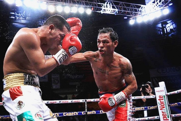 David Sanchez had his moments in the fight , but the challenger, Luis Concepcion, had more of them. (Photo: elimpartial.com)