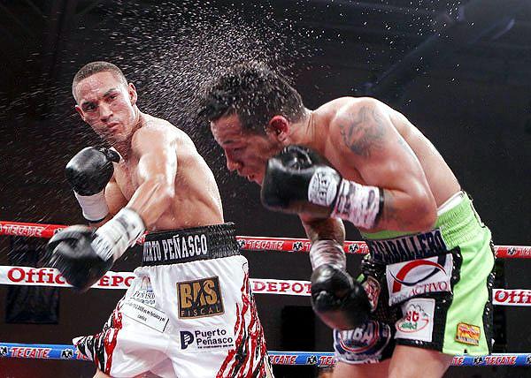 Estrada dropped Marquez seven times in the fifth defense of his WBA title. (Photo: Rafael Soto/Zanfer)