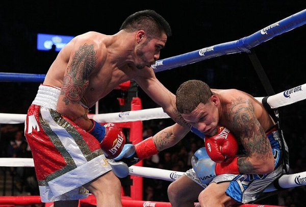 Cuellar landed 237 of 994 total punches (24%) to Oquendo's 167 of 639 (26%). (Photo: Ed Diller/DiBella Entertainment)