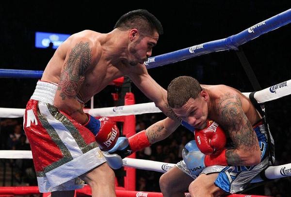 Cuellar Retains WBA Title in Style