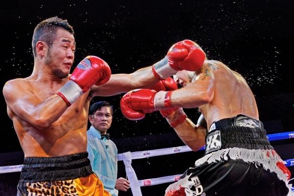 China's Qiu Xiao Jun Retains WBA International Title