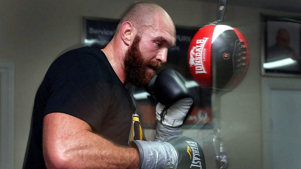 Don't panic. As it turns out, the reigning /WBA/WBO/IBO heavyweight champion isn't planning to retire. (Photo: Courtesy)