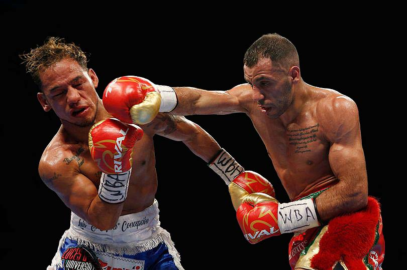 """""""Kal"""" outboxed Concepcion and dropped the former champion in round 10. (Photo: Reuters)"""