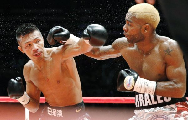 WBA super featherweight champion Jezreel Corrales (right) and Takashi Uchiyama exchange punches during Saturday night's title fight at Ota City General Gymnasium. Corrales recorded a split-decision win. | KYODO