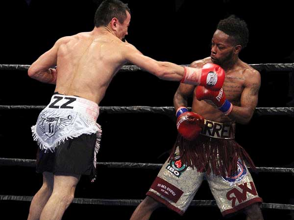 Zhakiyanov Upsets Warren via Split Decision
