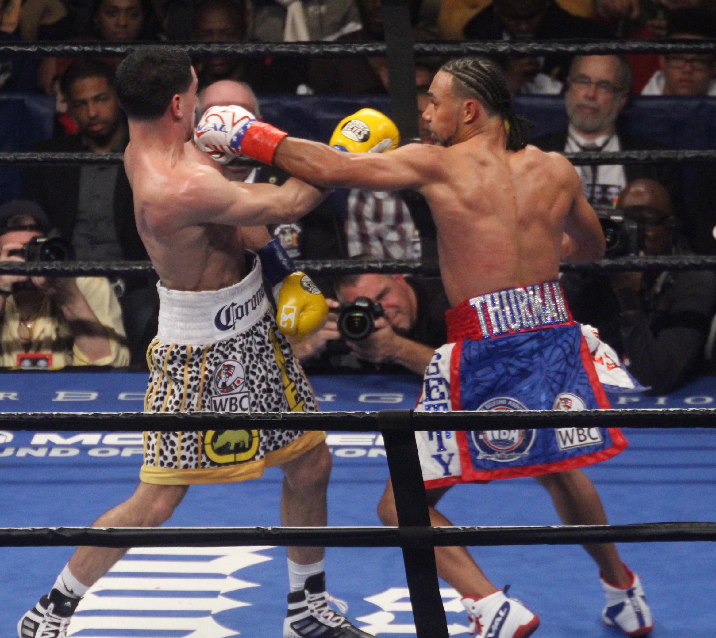 Thurman defeats Garcia in WBA/WBC welterweight title unification. Photos Sumio Yamada