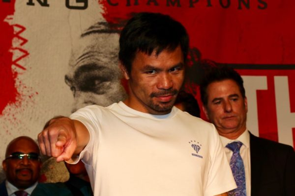 Pacquiao and Thurman have grand arrivals in Las Vegas