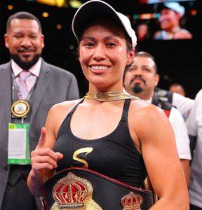 Estrada dominates Esparza to become Champion at 112 pounds